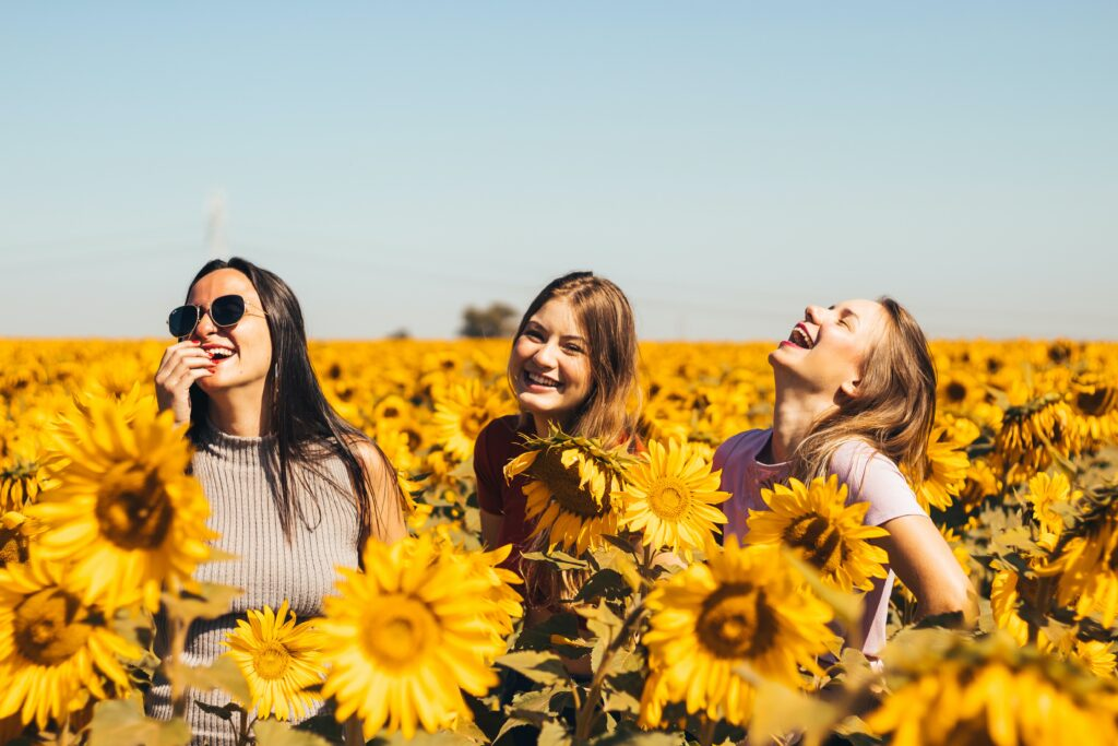 women in a sunflower field